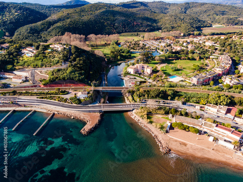 Fotografie, Obraz Aerial view of Small river flowing inside Mediterranean sea cote d'Azur turquois