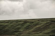 Gray Rainy Sky Over The Green Hills