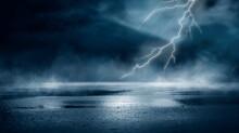 Dramatic Background Of The Night Sky, Thunderstorm, Lightning. Smoke, Fog, Smog Against The Background Of The City Landscape. Natural Night Landscape, Night Sky, Wet Asphalt, Puddles.