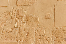 Ancient Egyptian Paintings And Hieroglyphs On A Wall In Mortuary Temple Of Hatshepsut In Luxor, Egypt