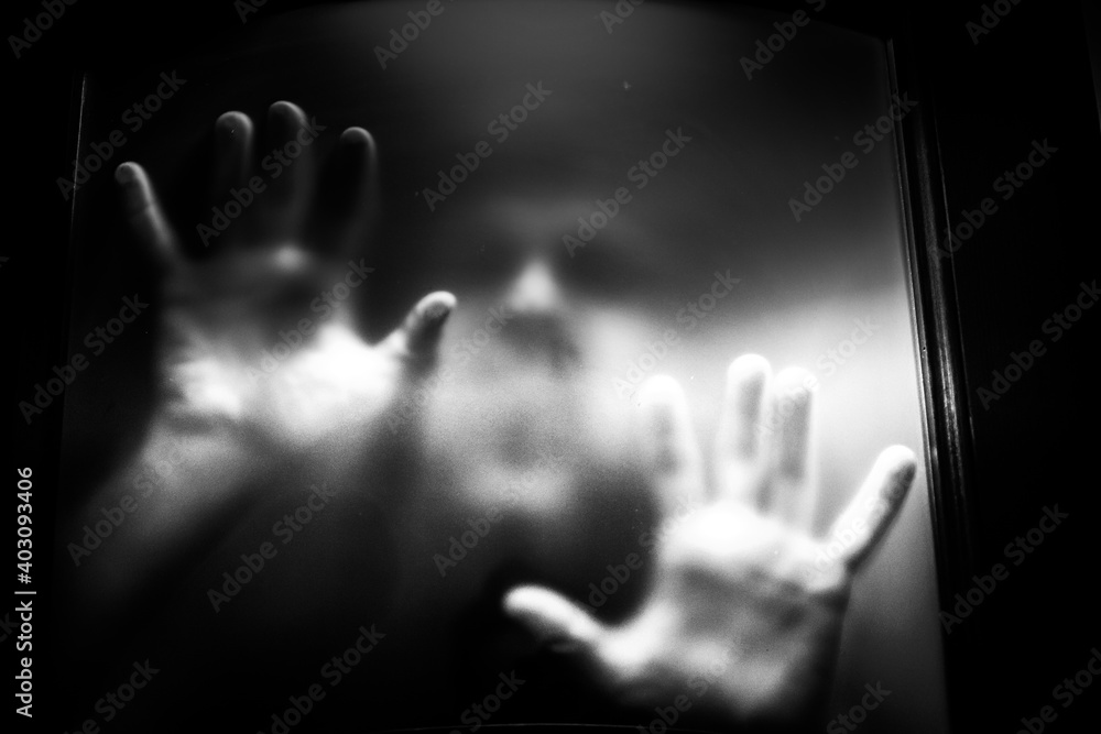 Fototapeta scary picture of hands behind glass