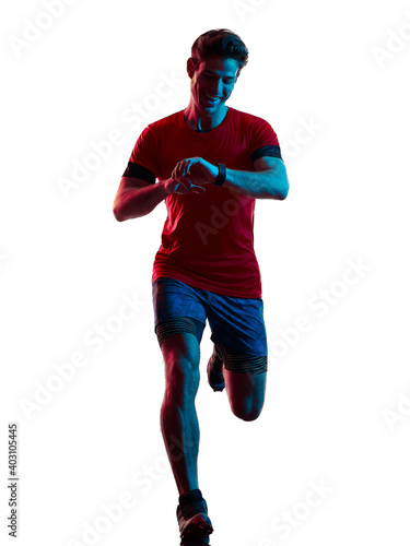 Fototapeta one young caucasian trail cross country runner running man silhouette shadow isolated on white background obraz