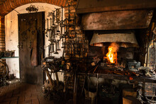 Interior Of Blacksmith Forge With Tools Hanging On Wall And Anvil And Hammer Ready To Be Used. Furnace Formant