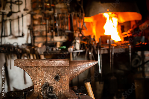 Tela Blacksmiths tools, hammer and anvil in old Blacksmiths workshop, an ancient craf