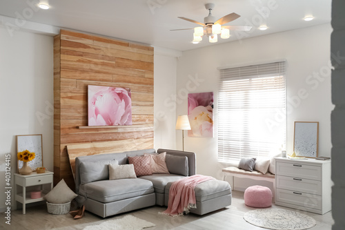 Canvas Print Stylish living room interior with modern ceiling fan and comfortable couch