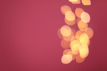 Blurred View Of Beautiful Lights On Pink Background, Space For Text. Bokeh Effect