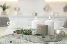 Beautiful Eucalyptus Branches, Flowers And Burning Candles On Napkin In Kitchen. Interior Element