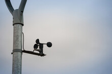 Anemometer Spinning And Turning In The Wind In Front Of A Grey Cloudy Weather. An Anemometre Is Used In Meteorology To Measure The Speed Of Wind