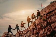 Group Of People On Peak Mountain Climbing Helping Teamwork , Travel Trekking Success Business Concept.