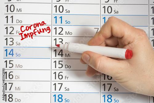 Ein Kalender und Termin für die Impfung gegen Corona Virus Fototapete