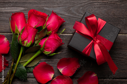 Valentines day greeting card with red rose flowers and gift box