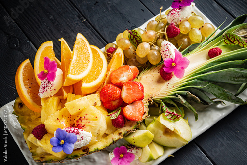fresh fruit and berries with edible flowers