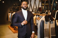 A Stylish Elegantly Dressed African-American Man Working At Classic Menswear Store.