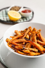 Bowl With Tasty Cooked Sweet Potato On Light Background