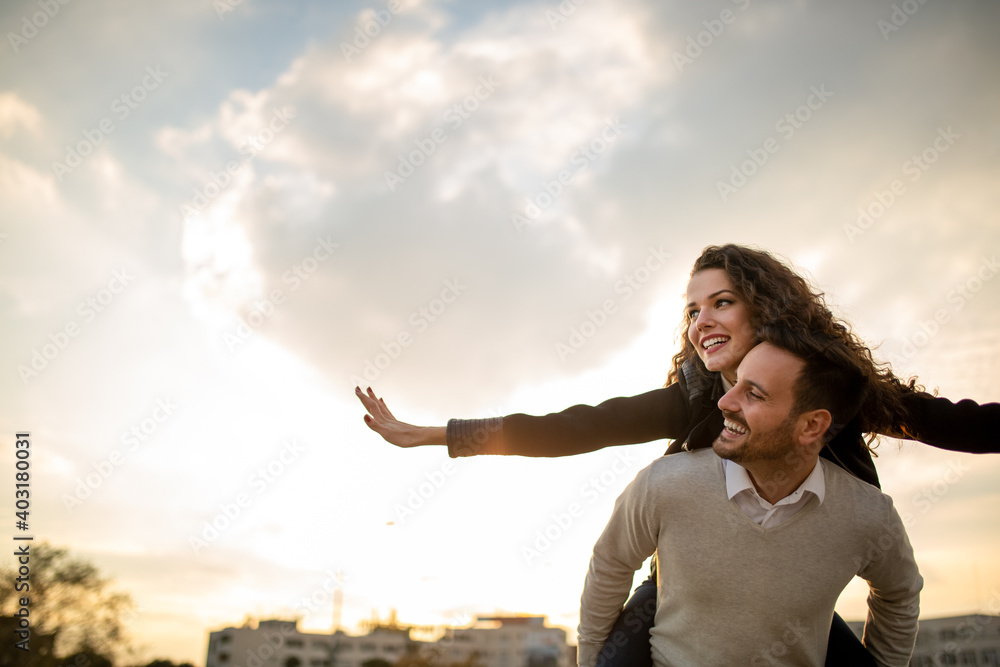 Fototapeta Happy young couple in love having fun and spending time together