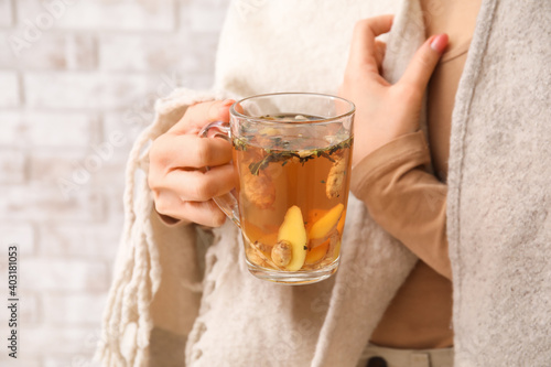 Obraz Woman holding cup of hot ginger tea, closeup - fototapety do salonu