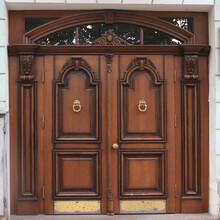 Big Old Closed Oak Door With Metal Door Knocker. Square Format.