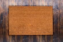 Natural Coir Doormat On Antique Wooden Texture, Background