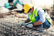 Asian Construction Worker On Building Site. Fabricating Steel Reinforcement Bar. Wearing Surgical Face Mask During Coronavirus And Flu Outbreak