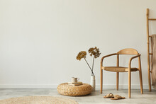 Neutral Concept Of Living Room Interior With Design Wooden Chair, Round Carpet, Dried Flowers In Vase, Stool, Slippers, Decoration And Elegant Personal Accessories. Template. Copy Space.