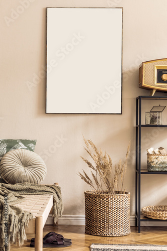 Interior design of korean style living room with modern chaise longue, pillow shelf, rattan basket, retro radio, flowers and elegant personal accessories. Mock up paintings on the beige wall. Template