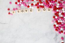 The Words I Love You Written In Scrabble Tiles On A Marble Kitchen Counter Top Surrounded By Valentines Candy