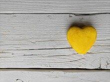 Yellow Heart On Gray Wooden Background