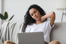 Brunette Woman Having Pain In Neck While Working With Laptop