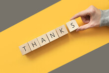 """Wooden Cubes With The Inscription: """"thanks"""" On Them. International Day Of """"thank You"""". Gratitude For Anything"""