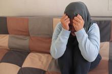 Sad Asian Muslim Woman Wearing Hijab Crying, Suffering From Headache Pain Or Having Stress Depression