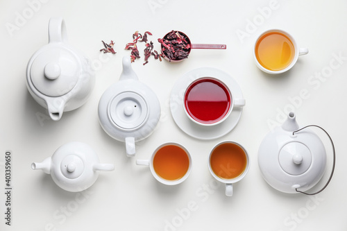 Obraz Composition with teapots and cups of tea on white background - fototapety do salonu