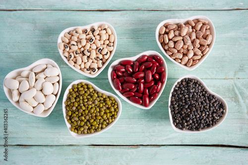 Fototapeta assortment of beans on wooden surface obraz