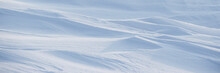 Snow Texture. Wind Sculpted Patterns On Snow Surface. Wind In The Tundra And In The Mountains On The Surface Of The Snow Sculpts Patterns And Ridges. Arctic, Polar Region. Winter Panoramic Background.