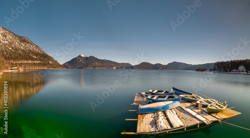Walchensee Bavaria Lake view with boats at the foreground and a mountain chain a Fototapete