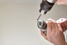 Bit For Drilling Holes In Glass Is Clamped In Chuck Of Electric Drill.