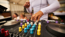 Dj Plays Beats On Drum Machine.Hip Hop Disc Jockey Playing On Concert Stage With Professional Midi Controller Device.