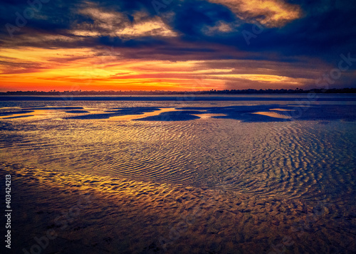 Fototapeta Sunsetting at low tide at Matanzas Inlet in St