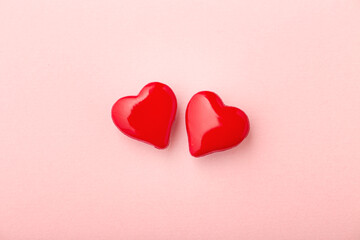 Two love hearts on pink background