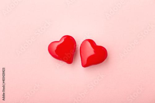 Obraz Two love hearts on pink background - fototapety do salonu