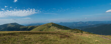Wide Panorama Of Grassy Green Hills And Slopes At Ridge Of Low Tatras Mountains With Hiking Trail Footpath, Mountain Meadow, And Pine Scrub, Slovakia, Summer Sunny Day, Blue Sky Background
