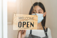 Owner Of Cafe Wear Protective Face Mask Flipping Open Sign After Reopen Business