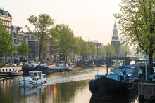 The Oudeschans Canal In Amsterdam And The Montelbaanstoren Tower