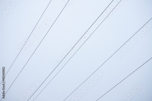 Fotografie, Obraz Photo of a power line wire against the sky