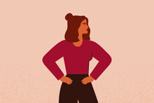 Young Strong Female With Hands On Her Hips Looks Forward. Confident Businesswoman Or Entrepreneur In Corporate Clothing. The Concept Of Gender Equality And Of The Female Empowerment Movement.