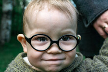 Portrait Of A Little Boy With Glasses, Smiling And Crying.