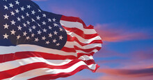 Flag Of United States Of America Being Waved In The Breeze Against A Sunset Sky.. US Flag