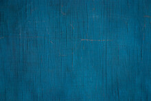 Dark Blue-green Texture Of Faded Plywood Wall With Cracks, Scratches And Stains