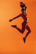 canvas print picture - Portrait of fit woman jumping in air during workout