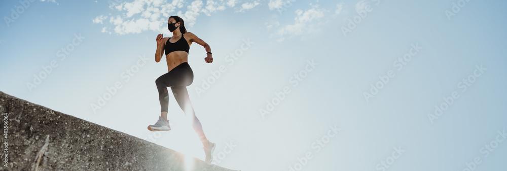 Fototapeta Woman doing running workout in morning