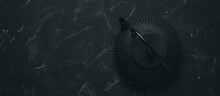Asian Black Metal Teapot On Black Stone Background. Cast Iron Teapot. Top View, Banner.